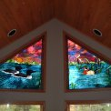 Loon/Wood Duck Trapezoid Window - This set of trapezoid windows was commissioned to me by a gentleman living in the Bradford Point Condominiums on Big St. Germaine Lake, a pristine vacation area located in the Oneida and Vilas County Forests in northern Wisconsin.  The love of nature is captivated by the loons and wood duck, cattails, and calm lake waters, all under sunset skies.